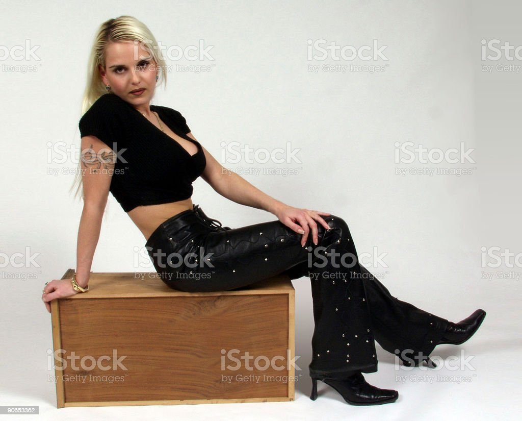 attractive woman seated on a wood box royalty-free stock photo
