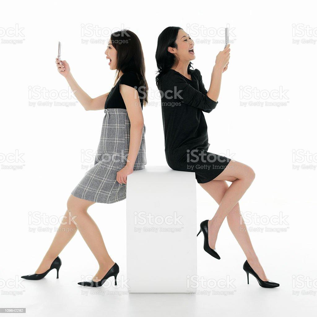 Attractive Woman Sending Each Other Playful Texts stock photo