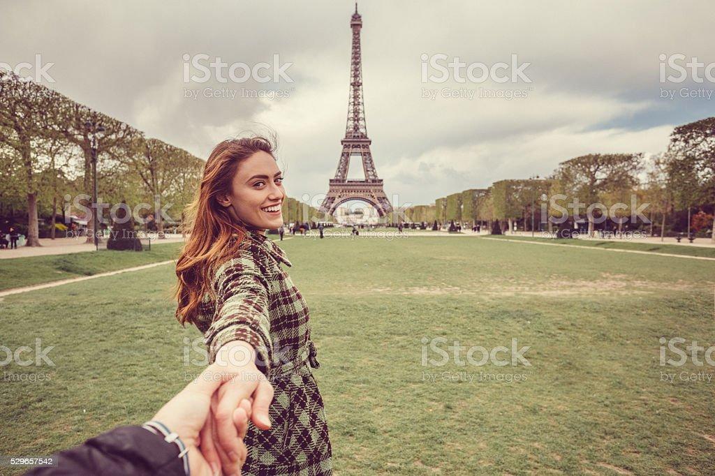 Attractive woman sightseeing Paris with her boyfriend stock photo