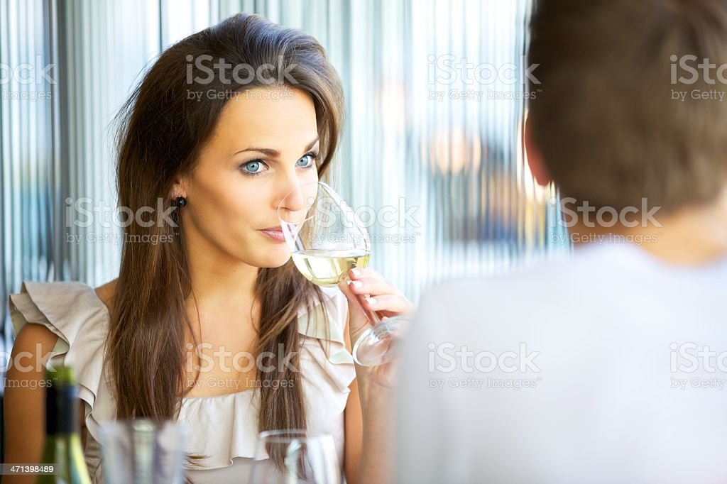 Attractive Woman Sipping Wine stock photo