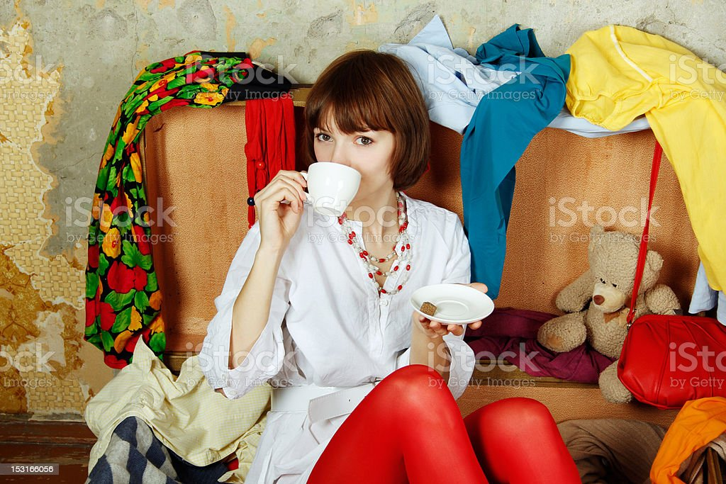 Attractive woman sitting in a suitcase royalty-free stock photo