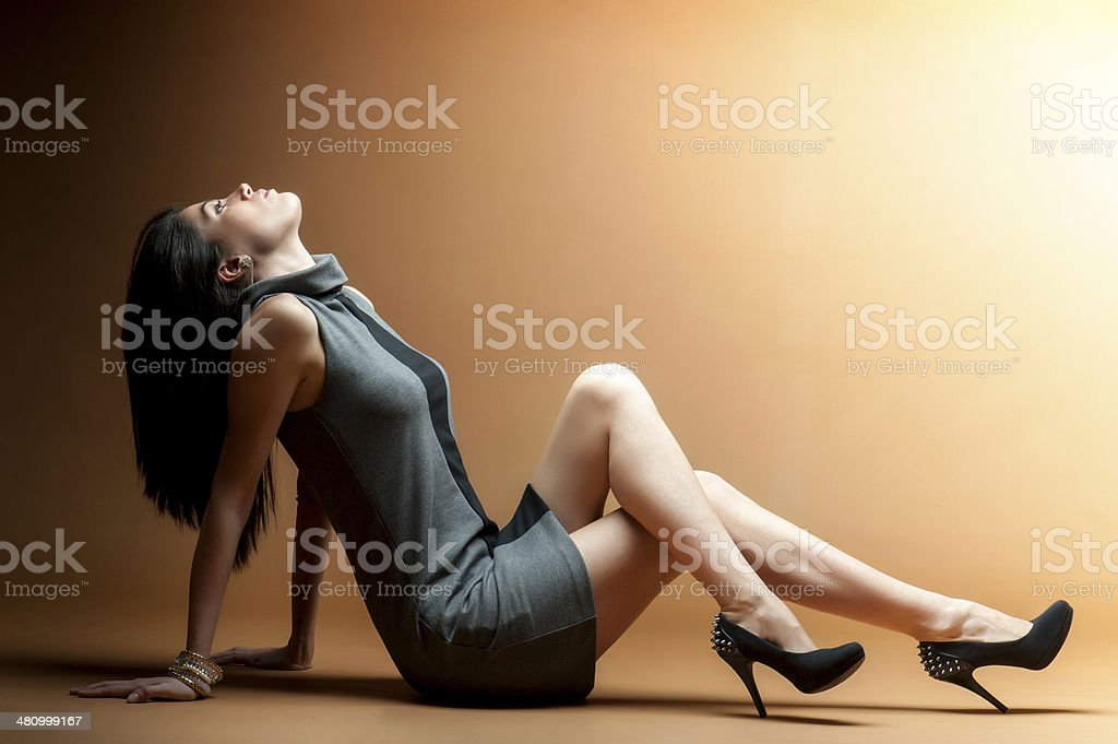 Attractive woman sitting on floor royalty-free stock photo