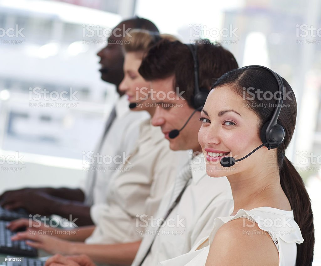 Attractive woman smiling with a headset on royalty-free stock photo