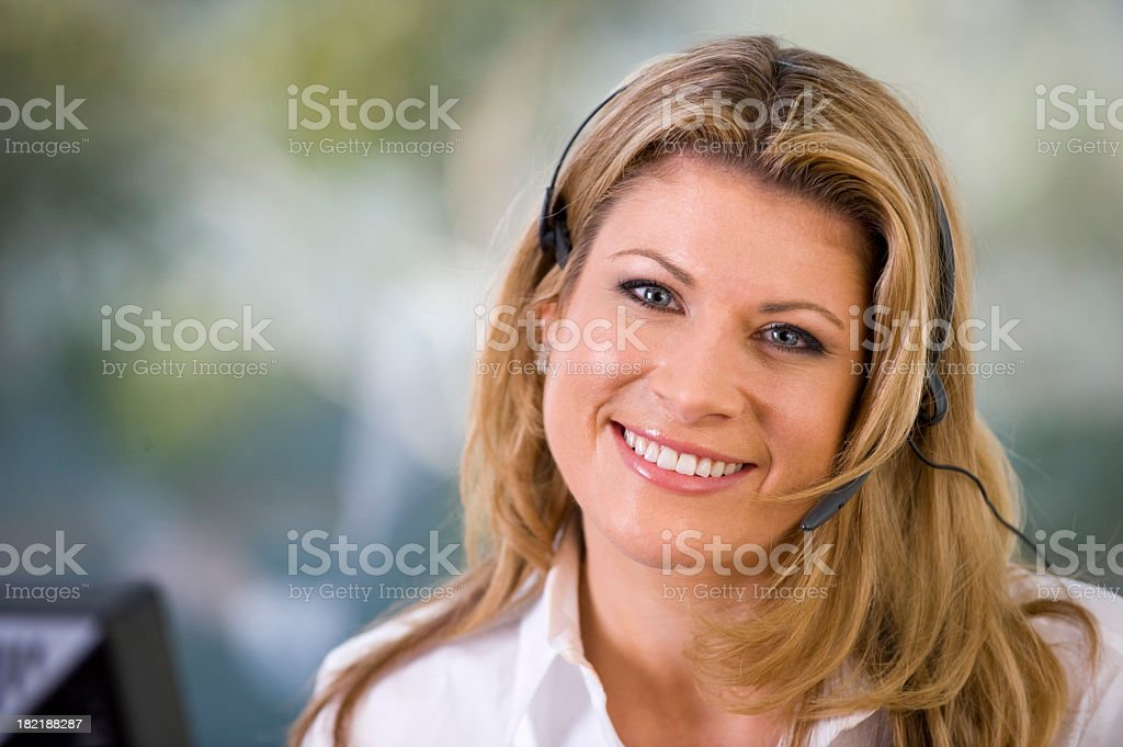 Attractive woman smiling with telephone headset stock photo