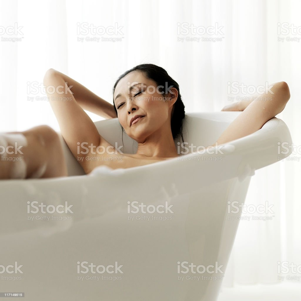 Attractive Woman Soaking In Bathtub Stock Photo & More Pictures of ...