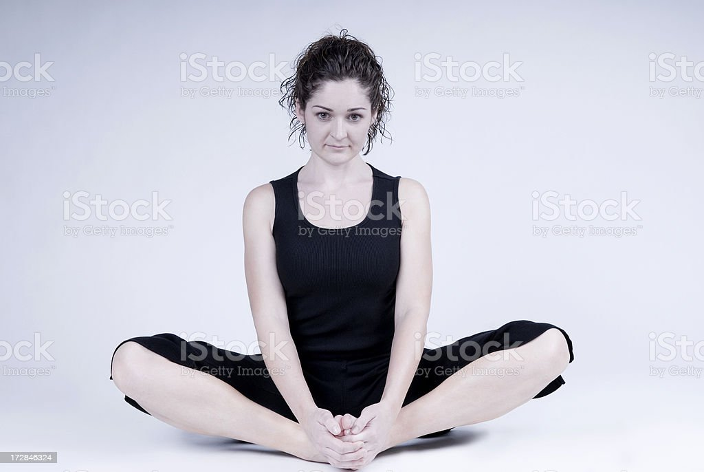 Attractive Woman Stretches stock photo