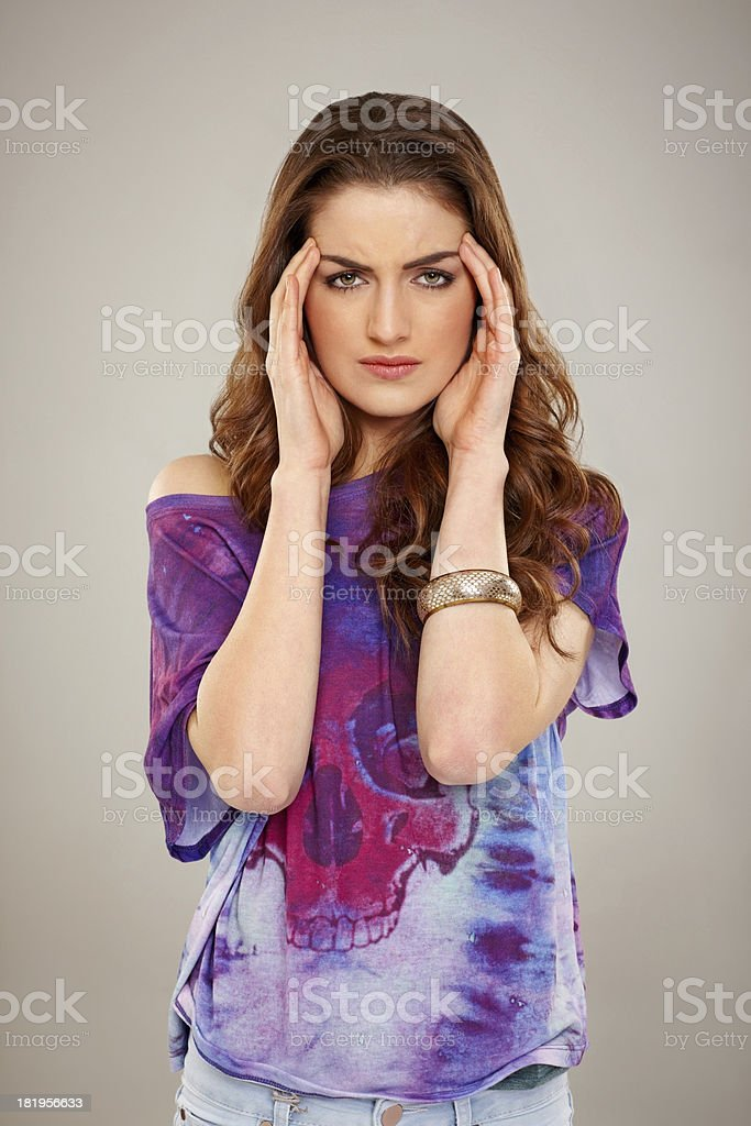 Attractive woman suffering from headache royalty-free stock photo