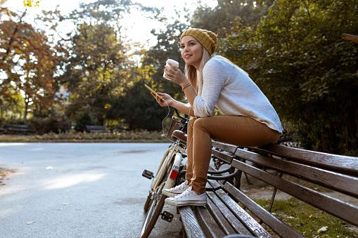Attractive woman taking a coffee break