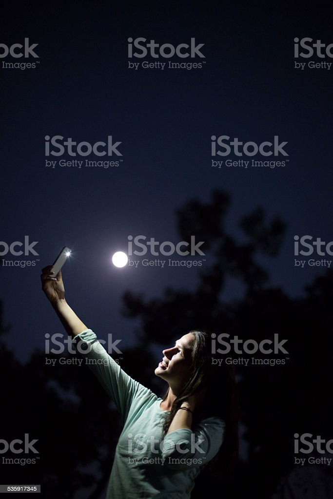 Attractive Woman Taking a Selfie with Cell phone stock photo