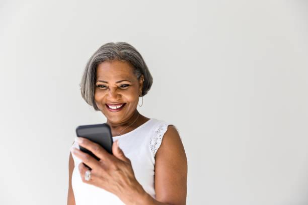 Attractive woman taking selfie stock photo