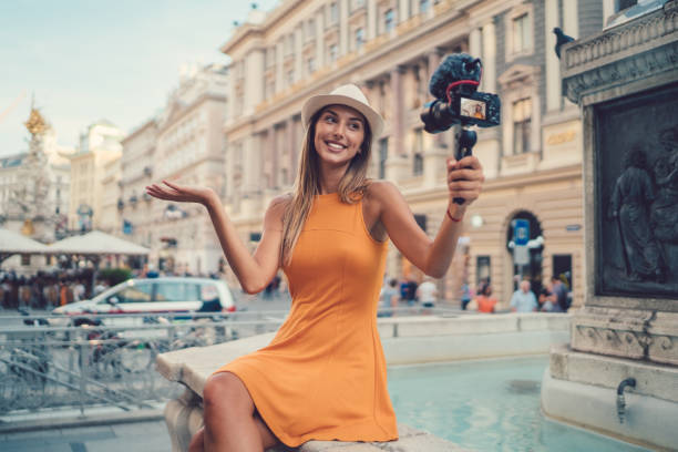 Attractive woman vlogging from Vienna stock photo