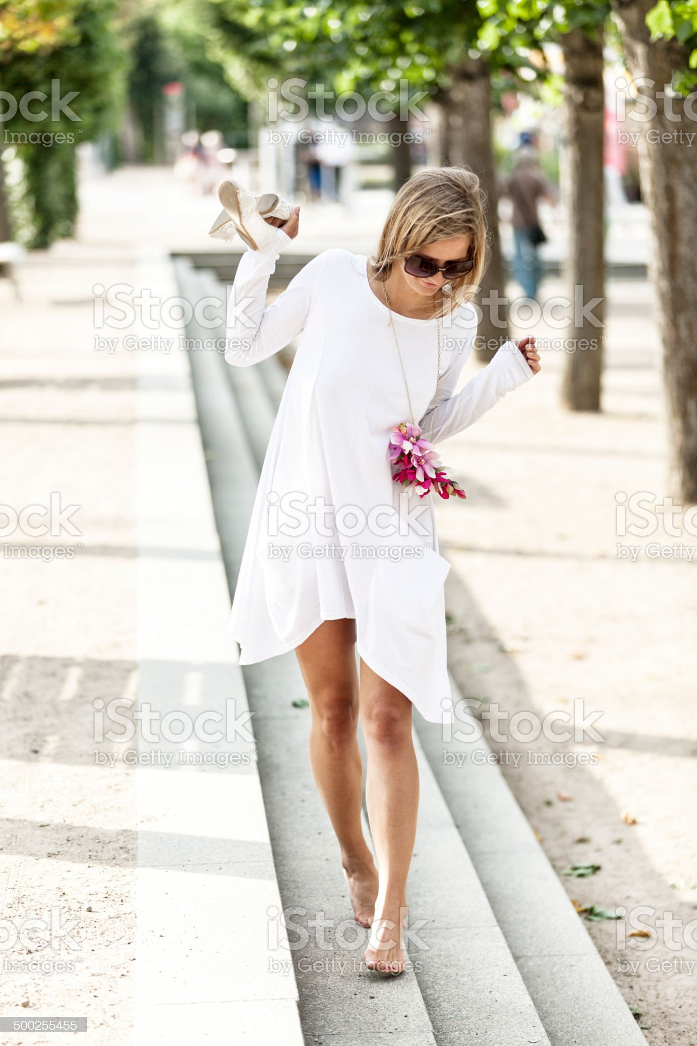 https://media.istockphoto.com/photos/attractive-woman-walking-on-pavement-picture-id500255455?s=2048x2048
