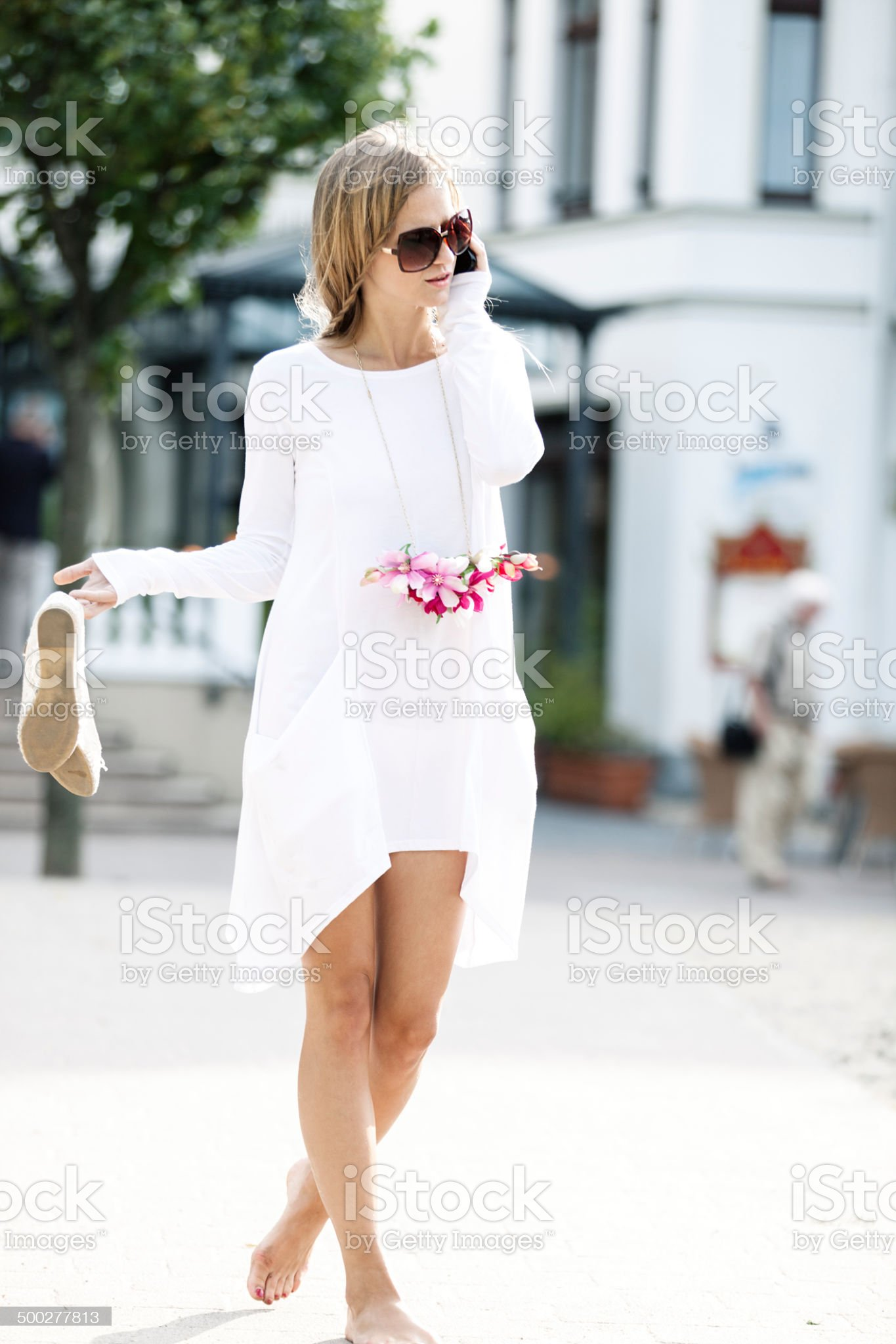 https://media.istockphoto.com/photos/attractive-woman-walking-on-street-picture-id500277813?s=2048x2048