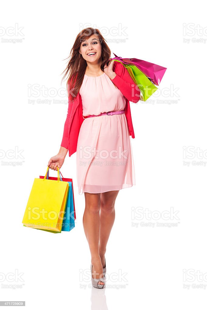 Attractive woman walking with shopping bags royalty-free stock photo