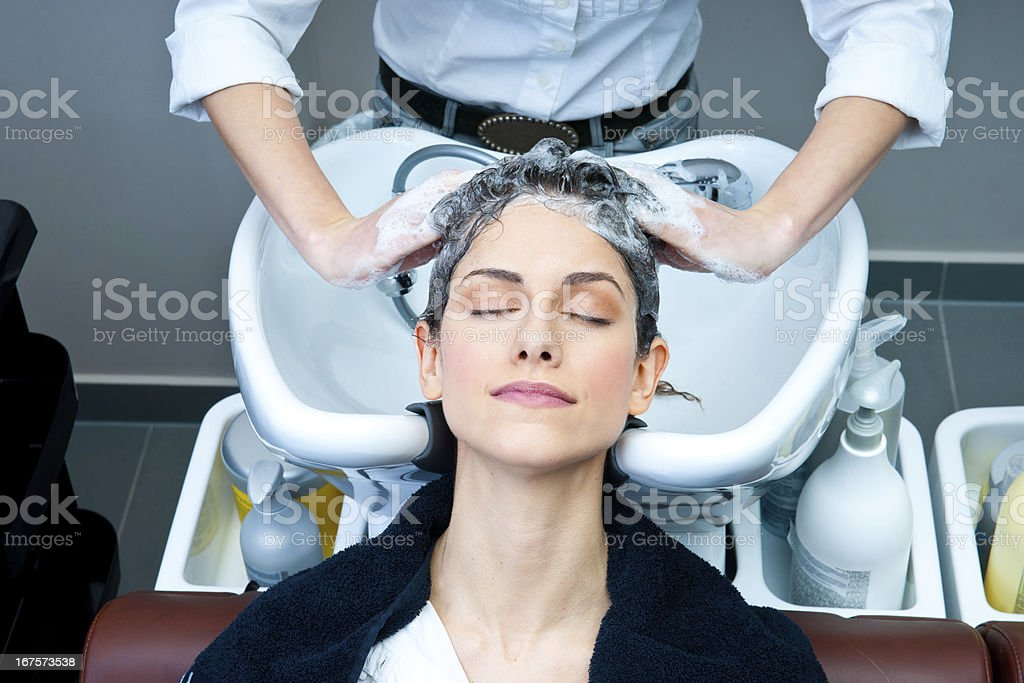 attractive woman washing her hair royalty-free stock photo