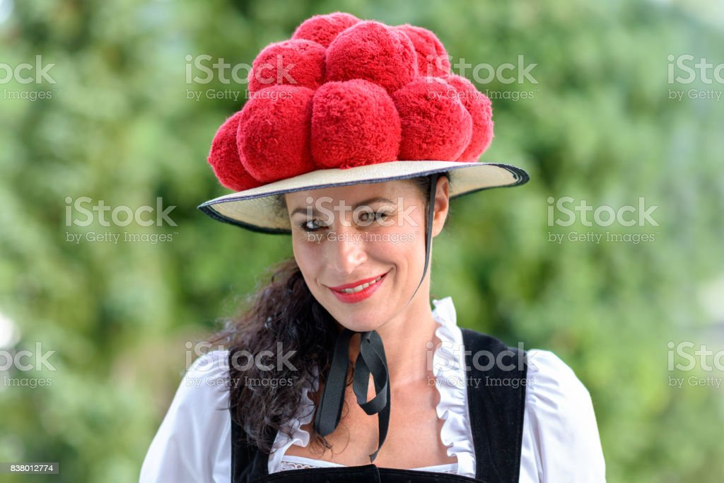 Attractive woman wearing a traditional Bollenhut stock photo