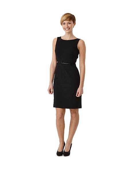 Attractive woman wearing black cocktail dress stock photo
