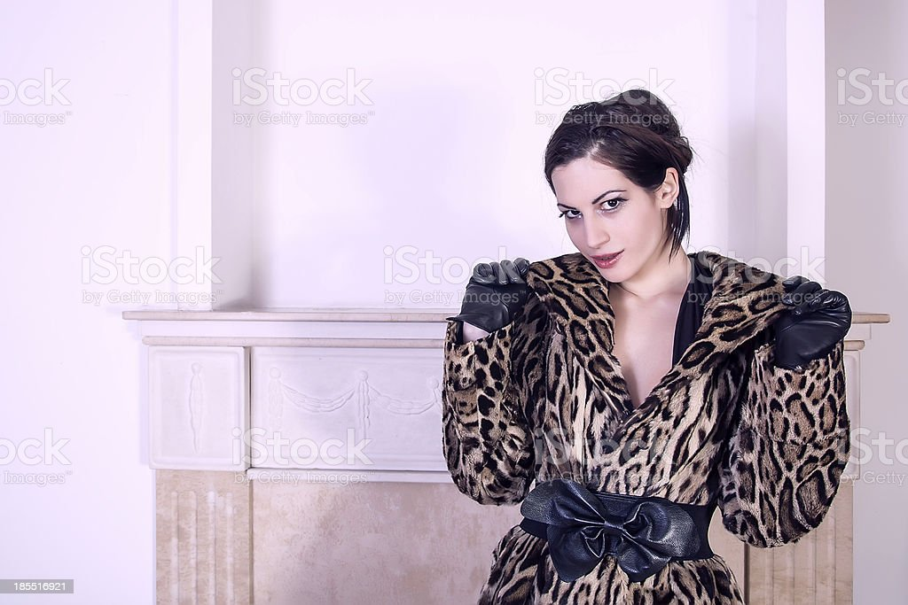 attractive woman wearing fur and leather royalty-free stock photo