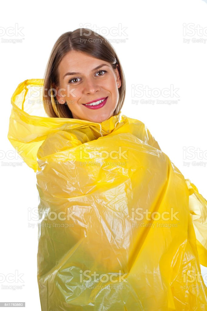 Attractive woman wearing yellow raincoat - isolated stock photo