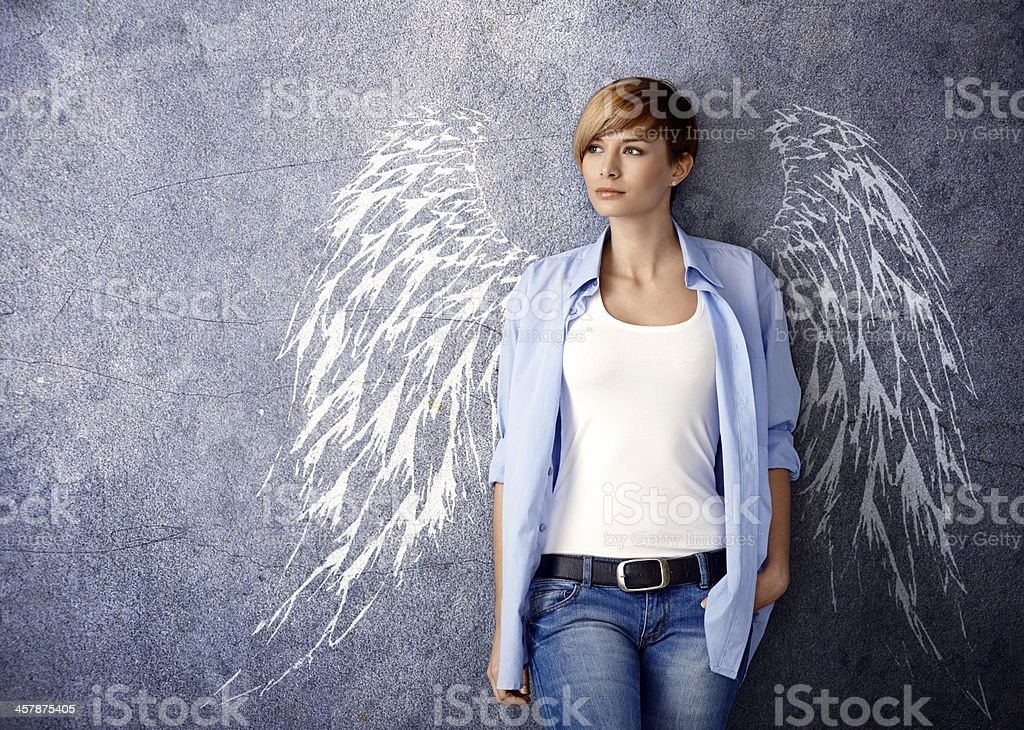 Attractive woman with angel wings stock photo