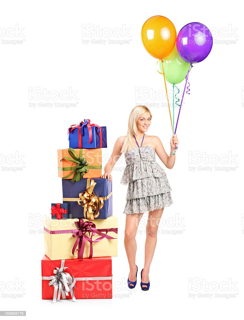 Attractive woman with balloons and gifts royalty-free stock photo