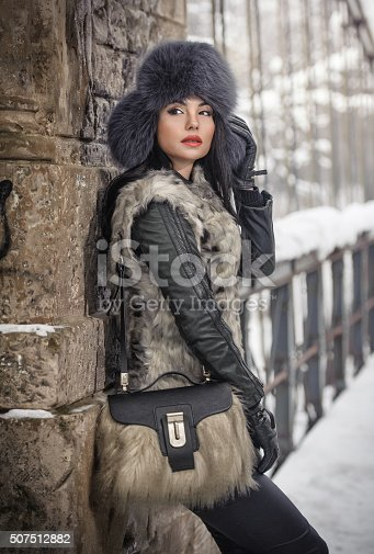 455111881 istock photo Attractive woman with black fur cap and gray waistcoat 507512882