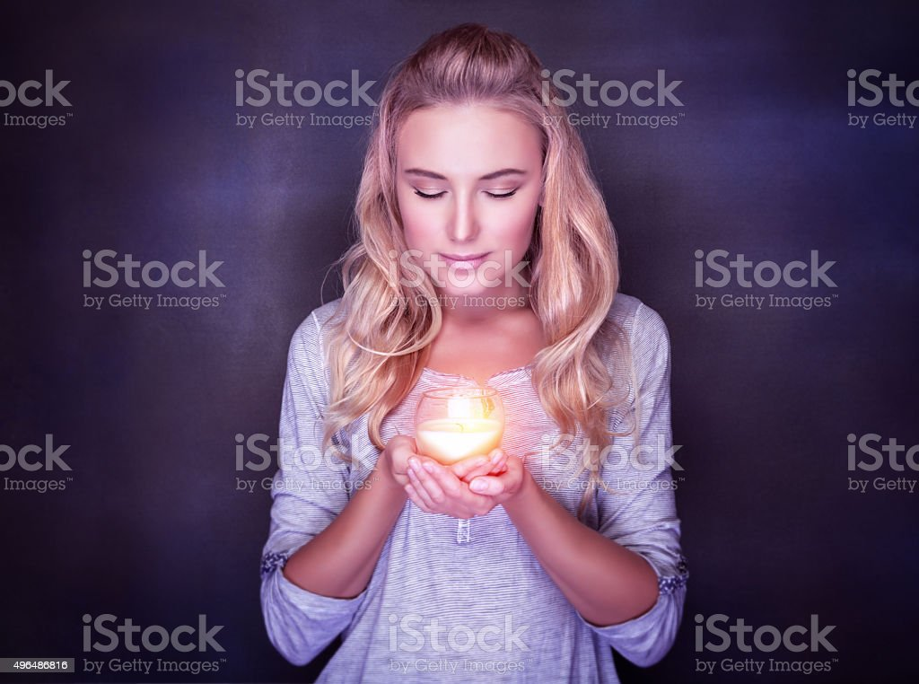 Attractive woman with candle stock photo