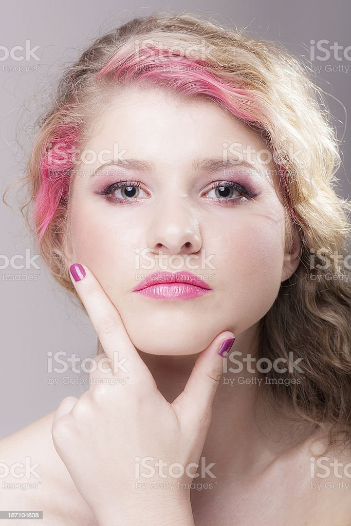 Attractive woman with colorful makeup and hairstyle stock photo