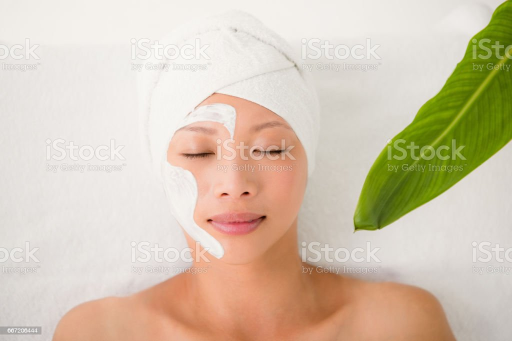 Attractive woman with cream treatment royalty-free stock photo