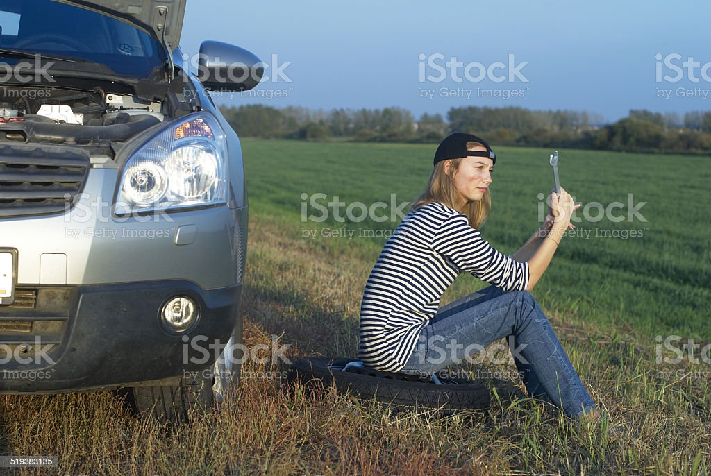 Attractive Woman With Her Broken Car stock photo