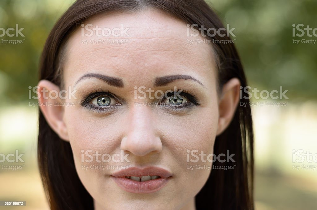 Attractive woman with lovely grey eyes stock photo