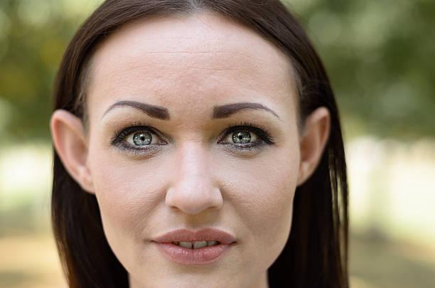 attractive woman with lovely grey eyes - penetrating bildbanksfoton och bilder