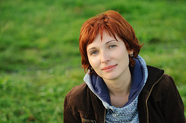 Attractive woman with red hair stock photo