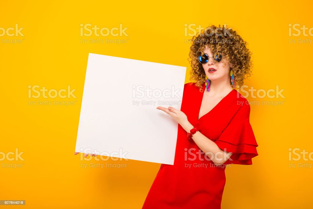 Attractive woman with short curly hair and banner - foto stock
