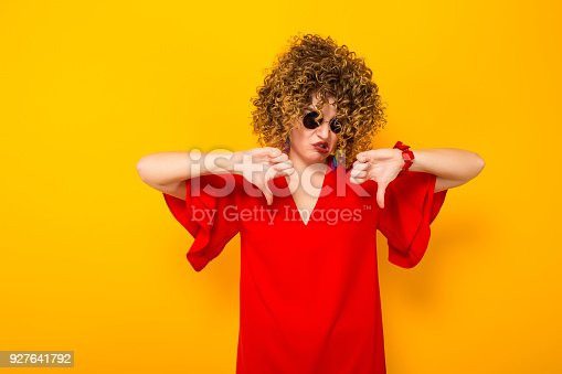 istock Attractive woman with short curly hair 927641792