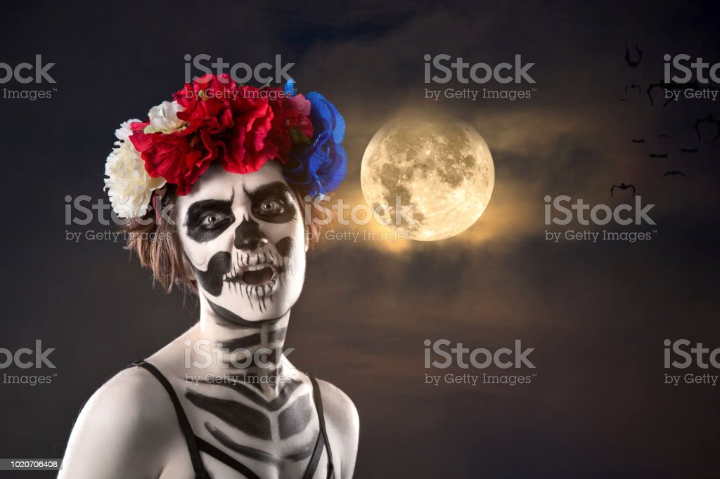 attractive woman with sugar skull make-up. Halloween stock photo