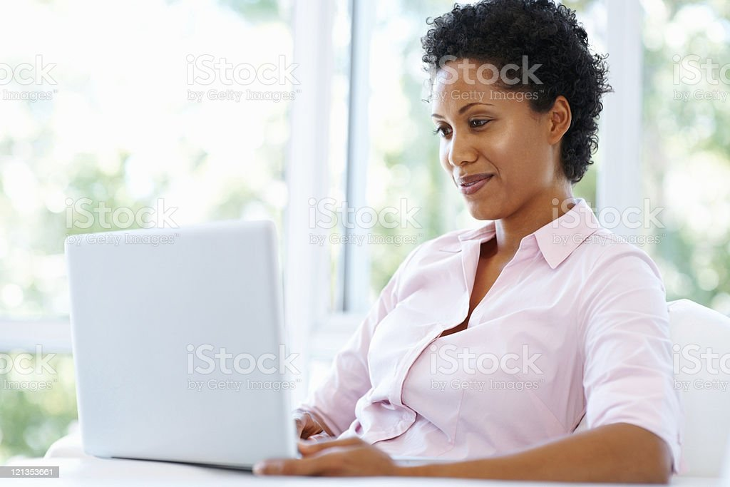 Attractive woman working on laptop royalty-free stock photo