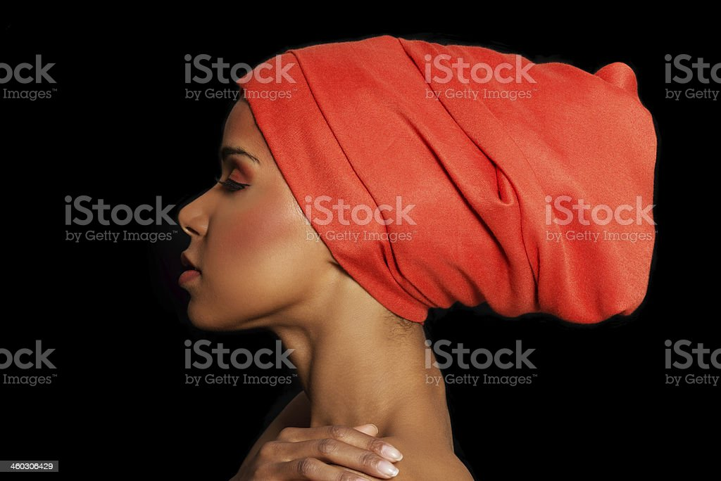 Attractive woman's profile in turban. Closed eyes. stock photo