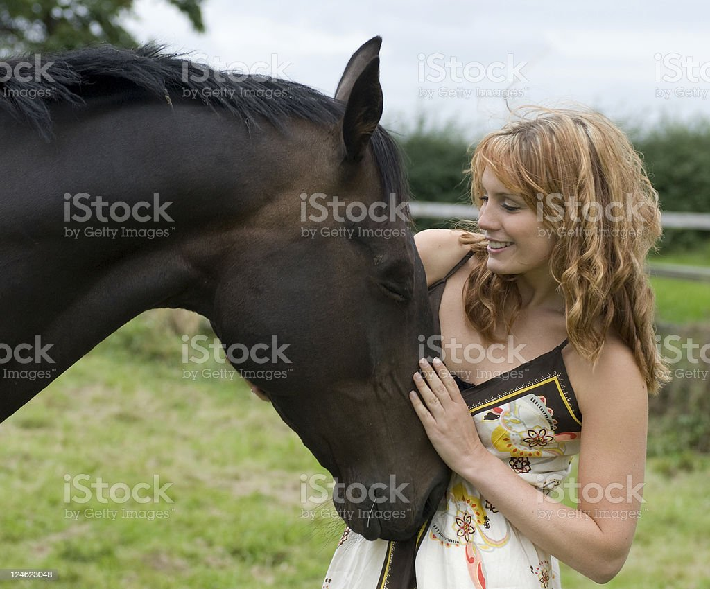 Attractive Women in summer dress with Horse royalty-free stock photo