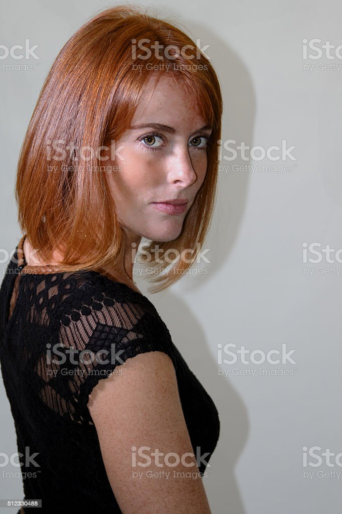 Attractive Young Adult Female Looking At The Camera stock photo