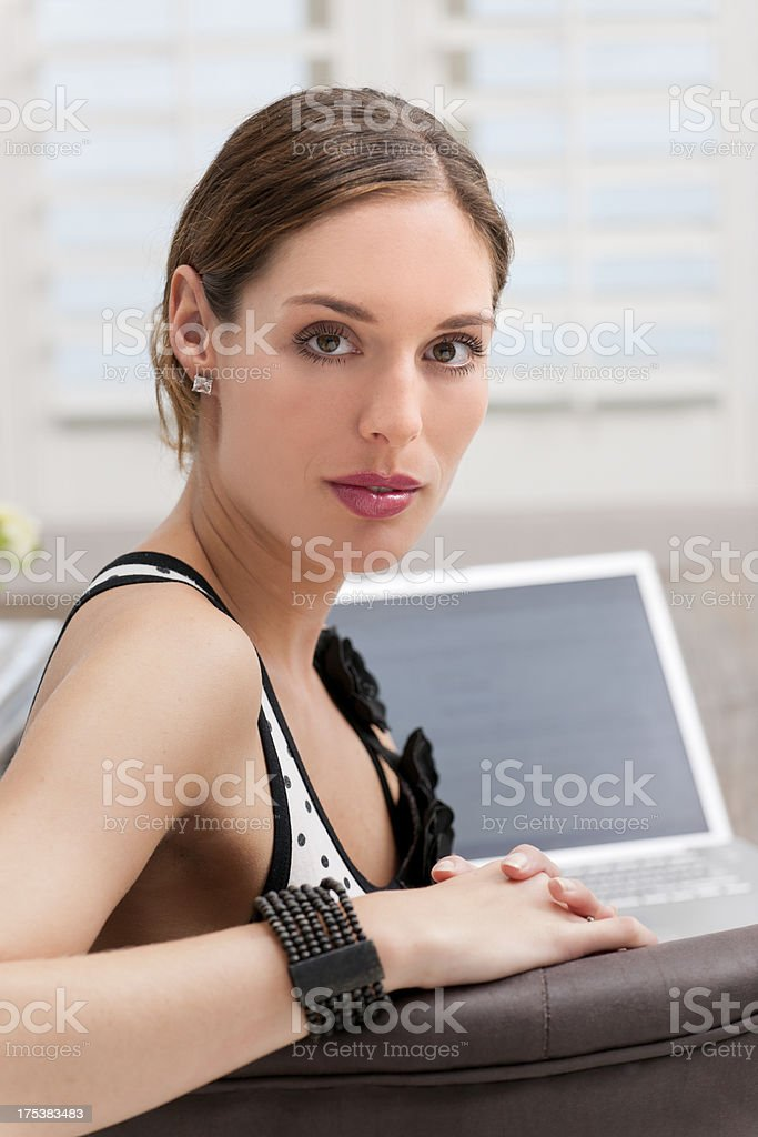 attractive young adult woman working on laptop royalty-free stock photo