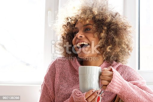 Portrait of attractive young african american woman holding holding cup of tea