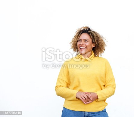 910856488 istock photo attractive young african american woman smiling and looking away against isolated white background 1137796419