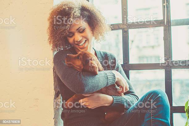 Attractive young african woman playing with puppy picture id504376928?b=1&k=6&m=504376928&s=612x612&h=8rujycewmkne q5uosydmnbzl23oa8iq00vq7hqtwpe=