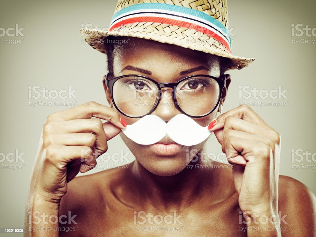 Attractive Young African Woman With Paper Moustache royalty-free stock photo