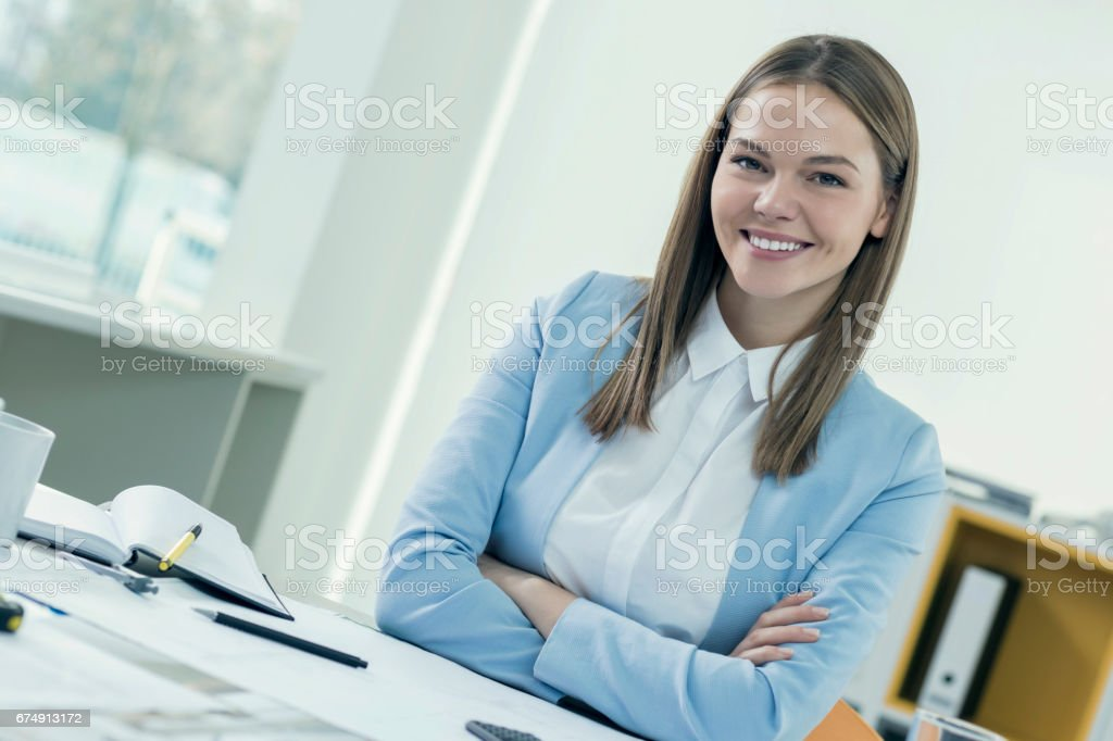 Attractive young architect working in her office royalty-free stock photo