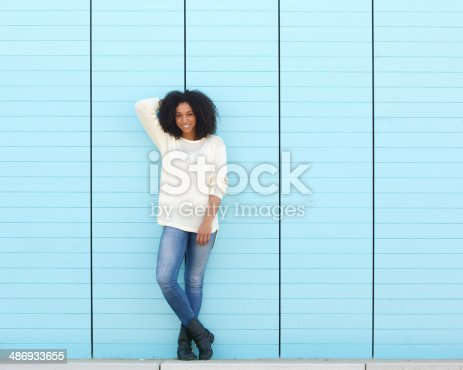 istock Attractive young black woman smiling outdoors 486933655