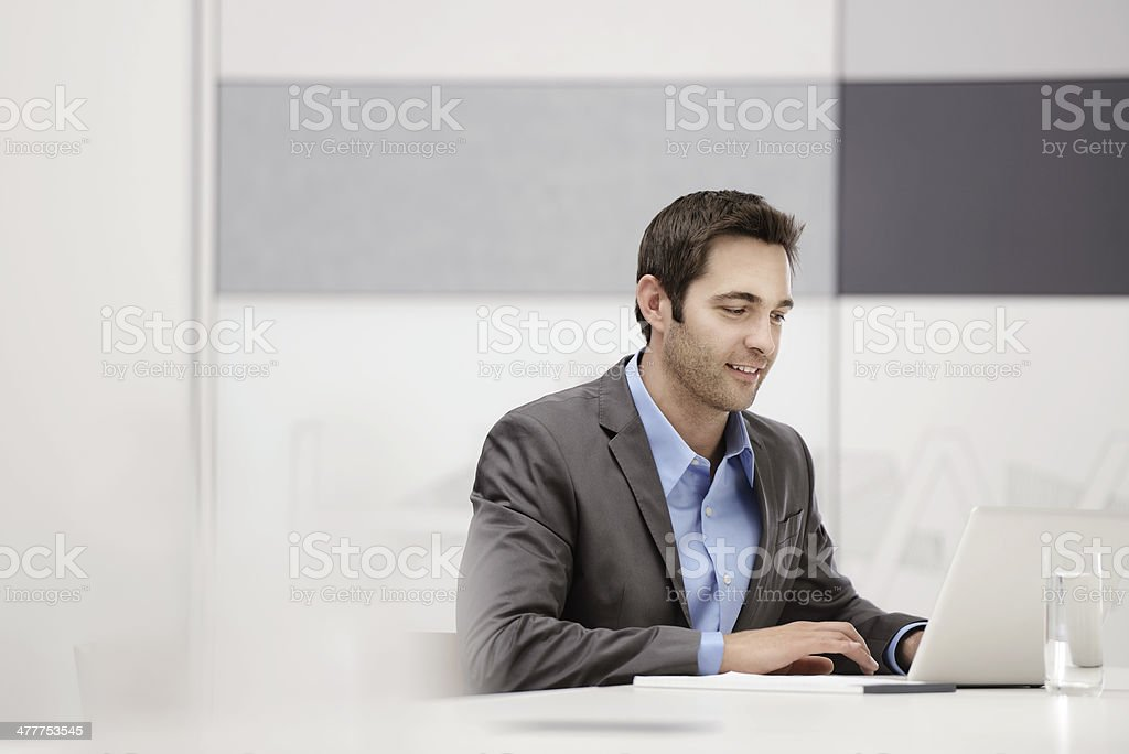 Attractive young business man stock photo
