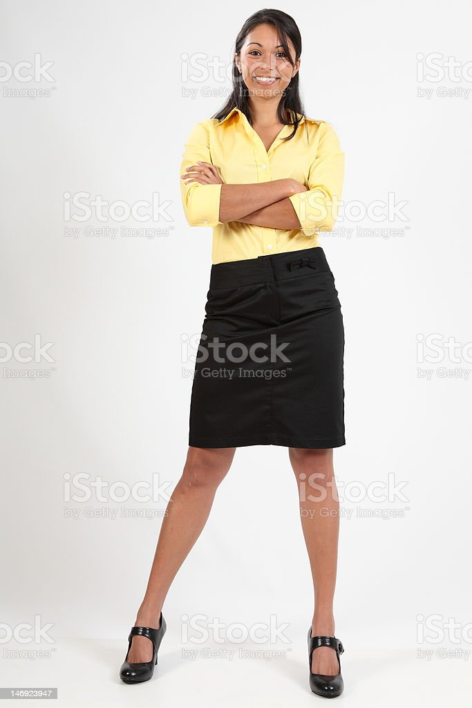 Attractive young business woman standing smiling with arms folded stock photo