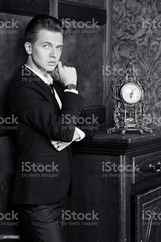 attractive young businessman in a suit, vintage interior stock photo